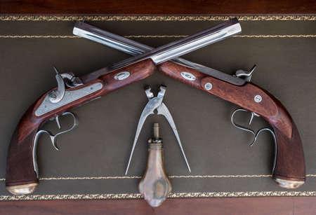 old pistol with equipment magazine powder 스톡 콘텐츠