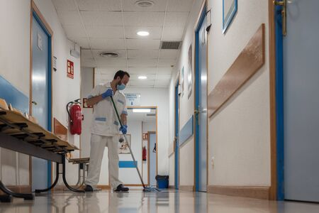 Cleaning staff cleaning hospital rooms