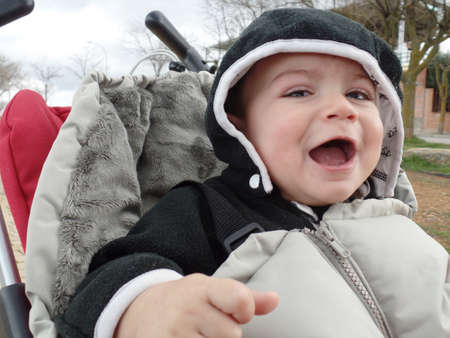 Surprised and happy baby while strolling in a stroller
