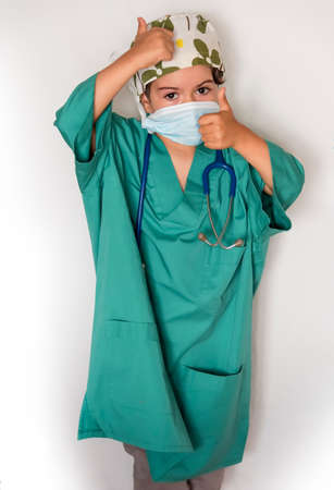 child dressed as a doctor. doctor-surgeon costume. child transplant. Stockfoto