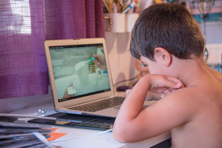 child watching recipes on a laptop computer