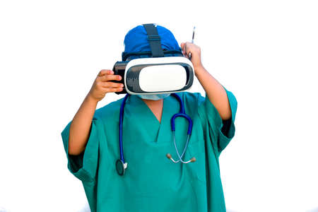 child dressed as a doctor with virtual reality glasses Stockfoto