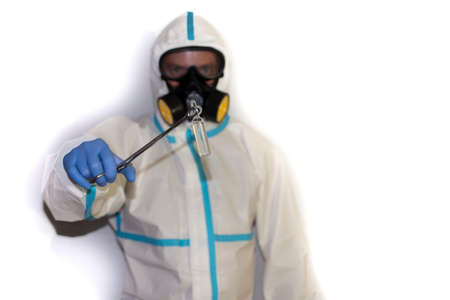 doctor with protective suit for covid19 with laboratory equipment White background. Stockfoto - 154834714