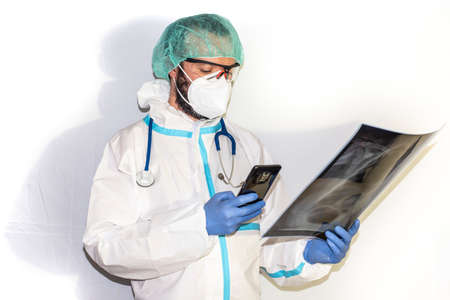 doctor with protective suit for covid19 with laboratory equipment. White background. Stockfoto - 154834730