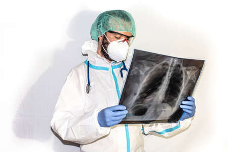 doctor with protective suit for covid19 with laboratory equipment. White background. Stockfoto - 154834738