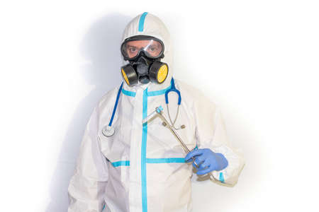 doctor with protective suit for covid19 with laboratory equipment. White background. Stockfoto - 154834739