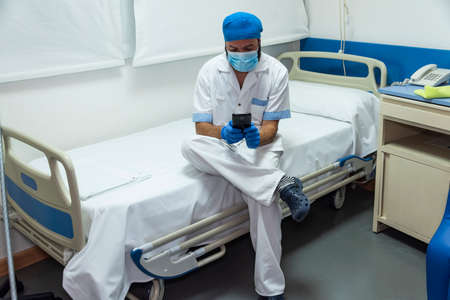 Conceptual photo of a hospital worker cleaning the ward Stockfoto - 155357346