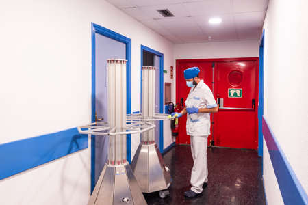 cleaning staff performing disinfection and hygiene work in hospital facilities Stockfoto
