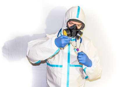 doctor in safety suit on white background. protection against coronavirus.doctor in safety suit on white background. protection against coronavirus.