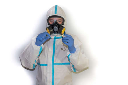 doctor in safety suit on white background. protection against coronavirus.