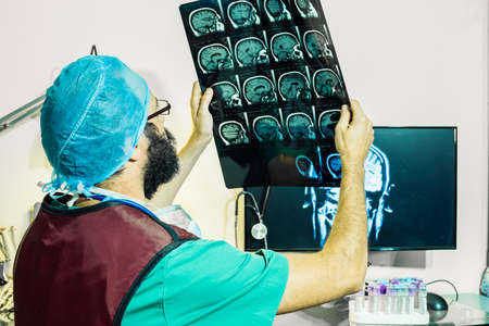 neurologist checking patient's magnetic resonance.