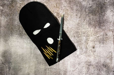 black thieving balaclava with automatic knife and war bullets