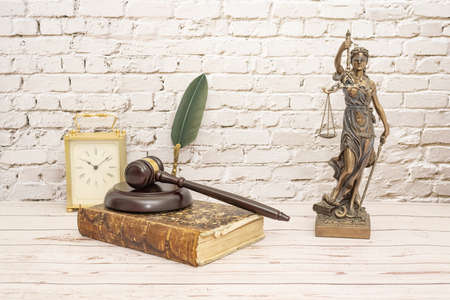 judge's gavel and symbol of justice whit book and clock.