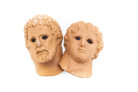 heads of jupiter and saturn made of clay.