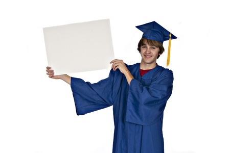 teenage graduate in blue gown smiling and holding a blank sign on white background Stock Photo - 8525480