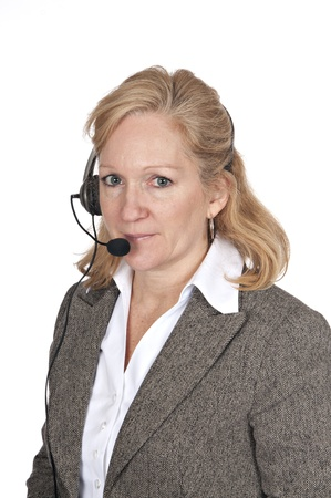 attractive blond woman in business attire wearing a headset on white background photo