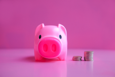 Piggy bank with pink background.