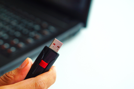 Close up of flash drive in hand. Reklamní fotografie