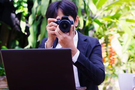 Pak Kret, Nonthaburi, Thailand. - On May 27, 2018 - The photographer is setting up the camera.