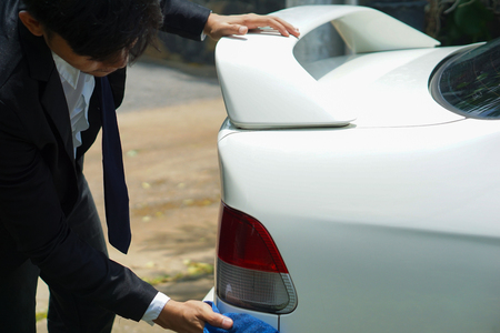 Pak Kret, Nonthaburi, Thailand. - On July 30, 2018 - Young man is cleaning the car. Standard-Bild