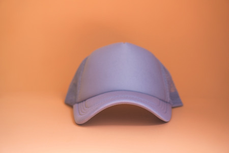 Gray cap Orange background. Standard-Bild