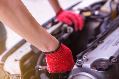 Pak Kret, Nonthaburi, Thailand. - On June 24, 2018 - The hand of the mechanic is repairing the car.
