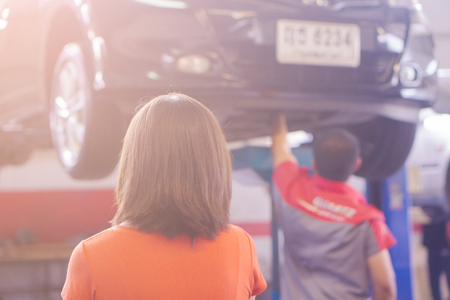 Pak Kret, Nonthaburi, Thailand. - On June 26, 2018 -  Women take the car into the center.