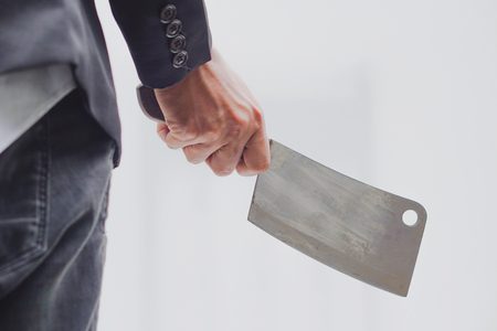 Man holding a white background knife. Standard-Bild