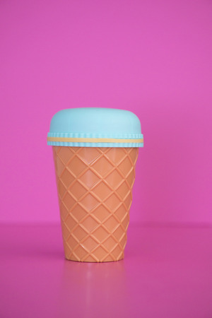 Plastic cup Pink background.