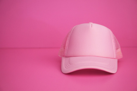 Pink cap On a pink background. Standard-Bild