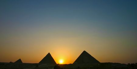 Sunset over gizah pyramids - Cairo photo