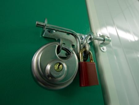self storage: 2 Padlocks on a self storage unit door