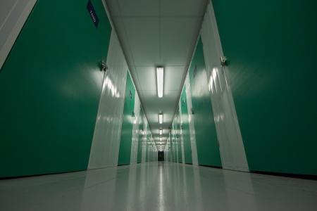 self storage: Self storage corridor with green doors