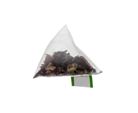 Luxury teabag isolated on White with label in Pyramid teabag photo
