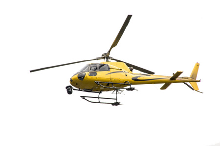 Isolated yellow helicopter with a camera mounted to the front Stock Photo