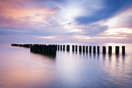 Sunrise over the Baltic sea, Poland  Wide landscape photograph of polish shoreline photographed at sunrise  Beautiful colorful summer scene full of warm colors  photo