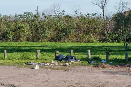 suburban: suburban road polluted with garbage. Stock Photo