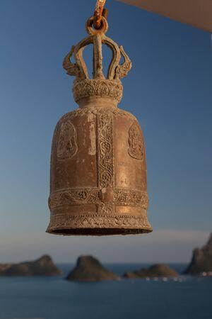 Bell at the ocean at Buddhist Temple Wat Khao Chong Kaeo. In Prachuap Khiri Khan, Thailand.
