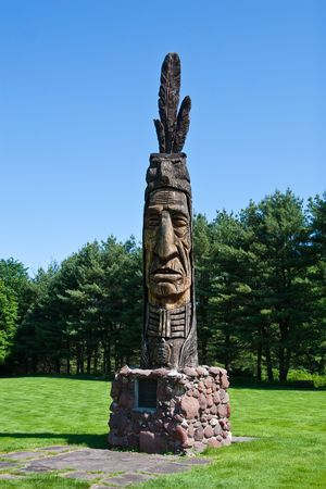 Carved Indian Head in a Park Stock Photo