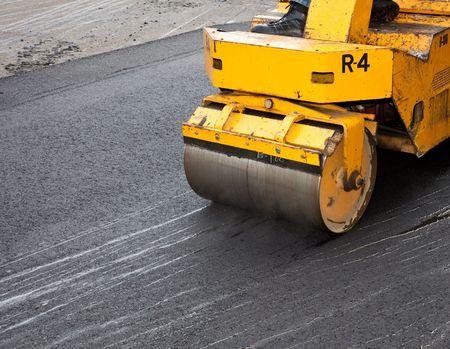 asphalt: Driveway Asphalt Crew Paving a Driveway at an Apartment Complex Stock Photo