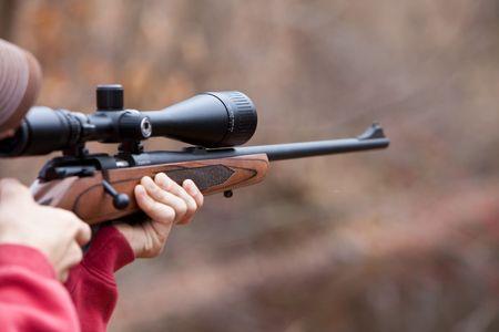 Firing a Rifle Фото со стока
