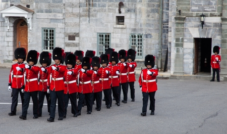 QUEBEC CITY, CANADA - JULY 5. Canadian Forces, Royal 22e Regiment, Honor Guard perform the Changing of the Guards on July, 2013 at the Citadel in Quebec City, Canada. The Changing of the Guard can be seen only in London, Windsor, Ottawa, and Quebec City.