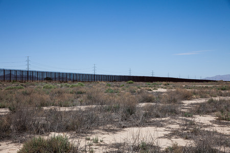 border patrol: The border fence near El Paso Texas that separates the United States from Mexico