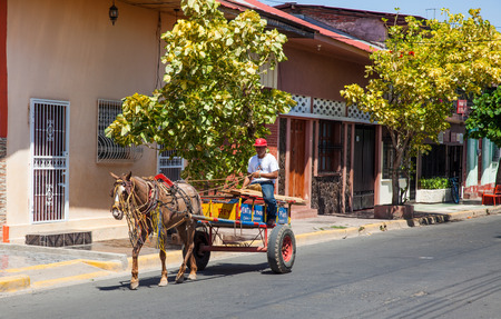 Horse-drawn wagon passing by, Granada, Nicaragua, 3 Mar 2016 Stock Photo
