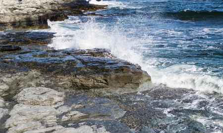 Waves crashing on to the Newport shore Stock Photo