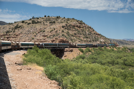 CLARKDALE, AZ  JULY 2.  Passengers aboard the Verde Canyon Railroad enjoy a scenic ride through Verde Canyon on July 2, 2017 at Clarkdale, AZ.