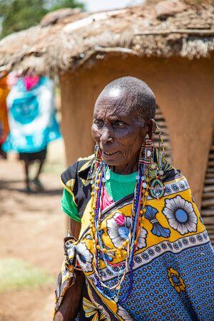 MASAI MARA, KENYA – AUGUST 15.  Maasai Woman in full ceremonial dress in a Maasai Village in the Masai Mara, Kenya – 15 Aug 2019 Редакционное