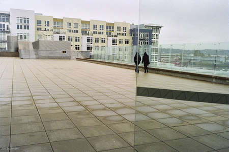 2 Hooded Figures on a large plaza. Tacoma,WA Date unknown.   Editorial