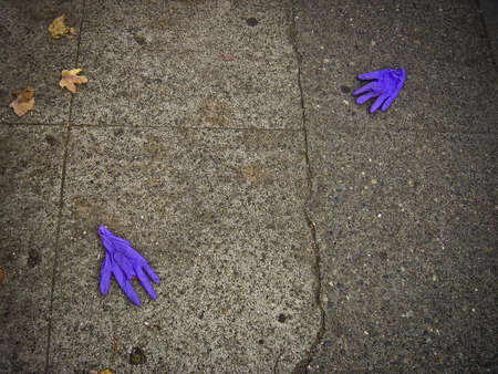 Two Blue Gloves on the Street Editorial
