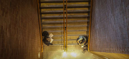 stair well: Overhead view of students studying in a stair well.